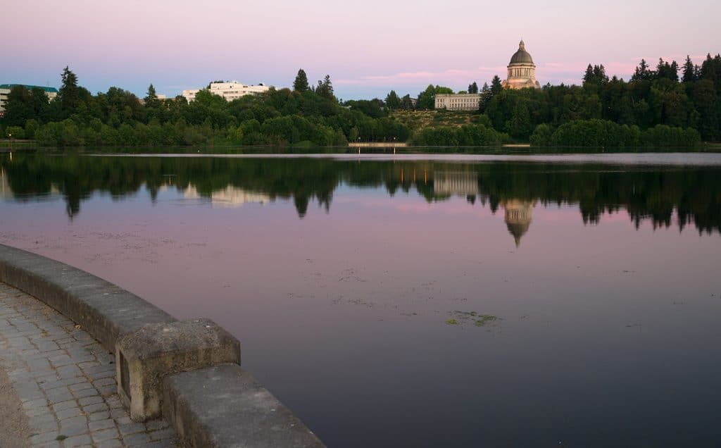 The state capital reflects in the lake of the same name at dusk in Olympia Wa