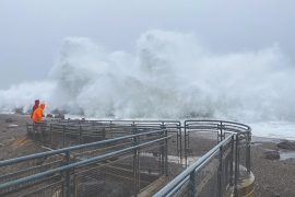 King tide waves delight (and terrify) spectators at the Westport Viewing Tower.