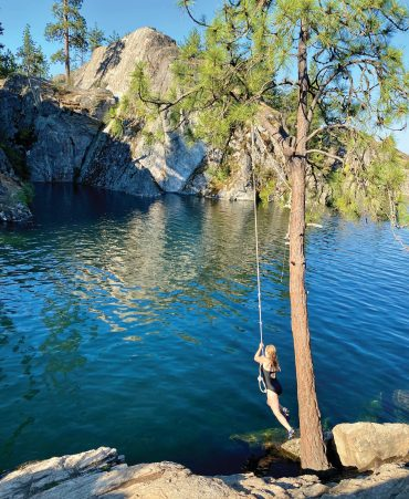 Swimmers can leap from a rope swing into The Cove at Fisk State Park.
