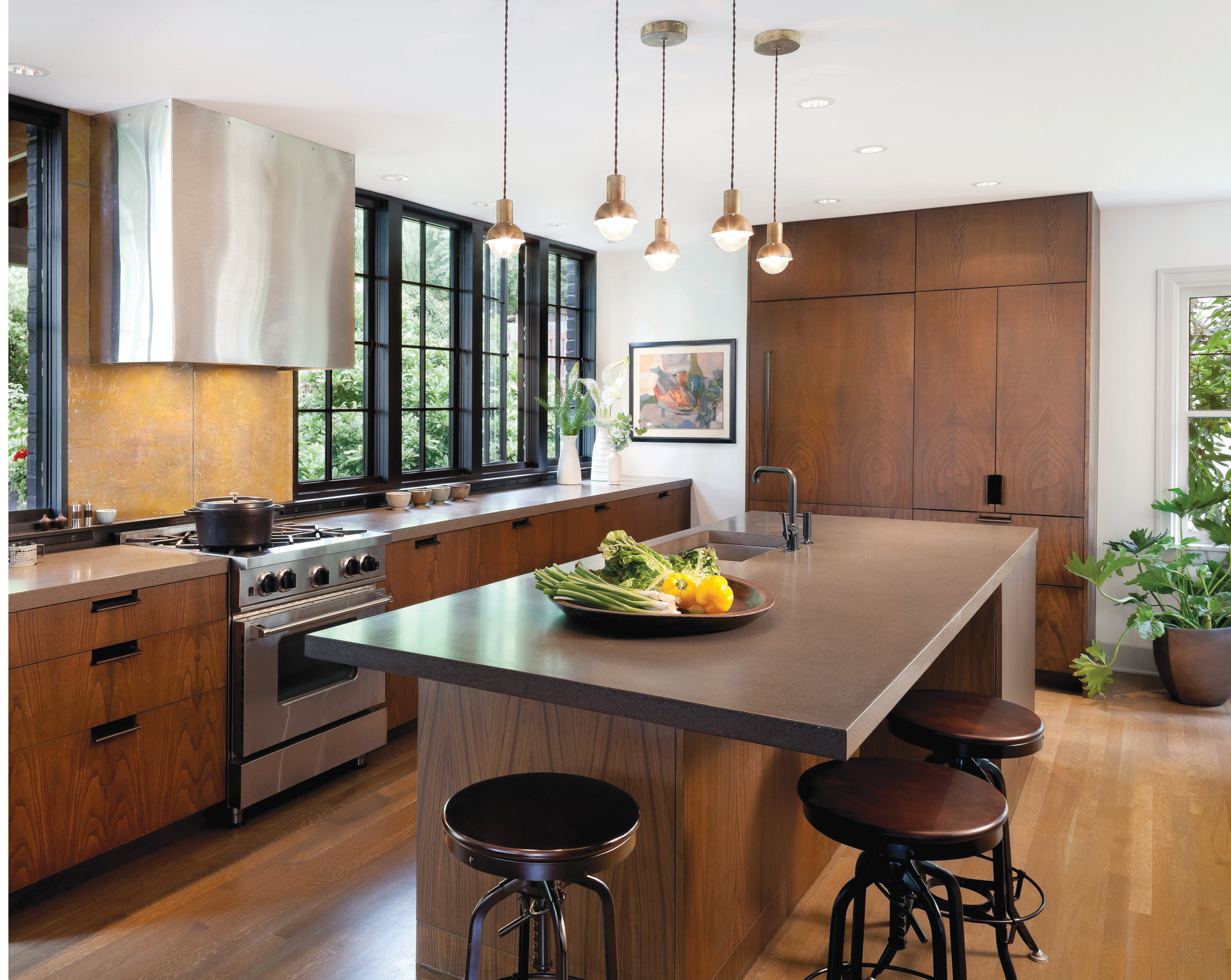 Windows from counter to ceiling let the light in to this Seattle Tudor kitchen.