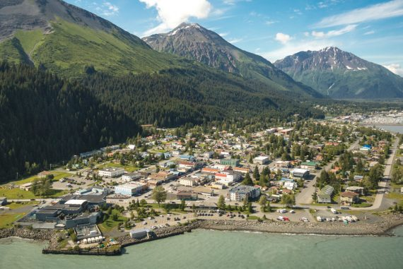 Magnificent glacially carved peaks tower over historic Seward, off a fjord on the Kenai Peninsula.