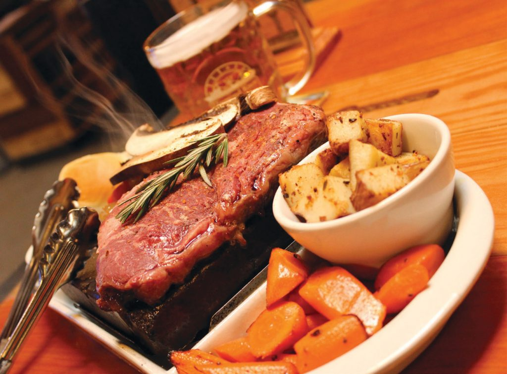 Diamond Knot Brewing serves steak along with a 750-degree granite rock that you use to cook the meat to your preference.